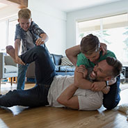Dad wrestling with kids