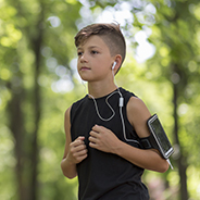 Tween boy running with iPod